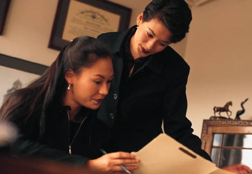 two women looking at a file